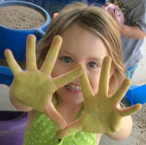 girl-with-paint-on-hands